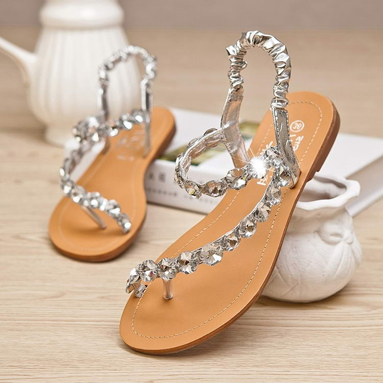 Leather soles keep the shoes sturdy during events. Wear the durable wedges during an outdoor event such as a wedding. Enjoy the evening and wear shiny shoes that look lovely with enchanting apparel. Besides events, make an impact at the pool as well and wear flat sandals adorned with rhinestones.