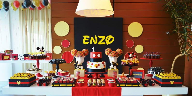 amazingly mix and match colored sweets and desserts with a eye popping back drop has balanced the total look of the table giving a second look for anyone